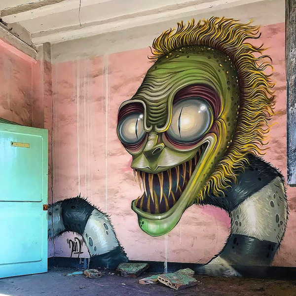 Barcelona street artist, David L, and his graffiti rendering of actor Micheal as Beetlejuice.